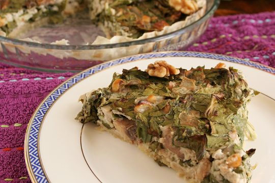 a ready and yummy piece of swiss chard and mushrooms pie